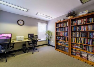 Business center with books and computers in Emmaus, PA apartment community