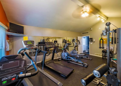 Fully equipped fitness center at The Meadows apartment complex