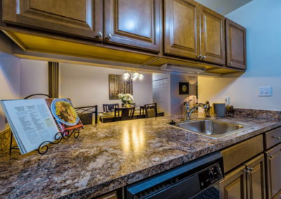 Granite countertops in Emmaus, PA apartments kitchen with wooden cabinets