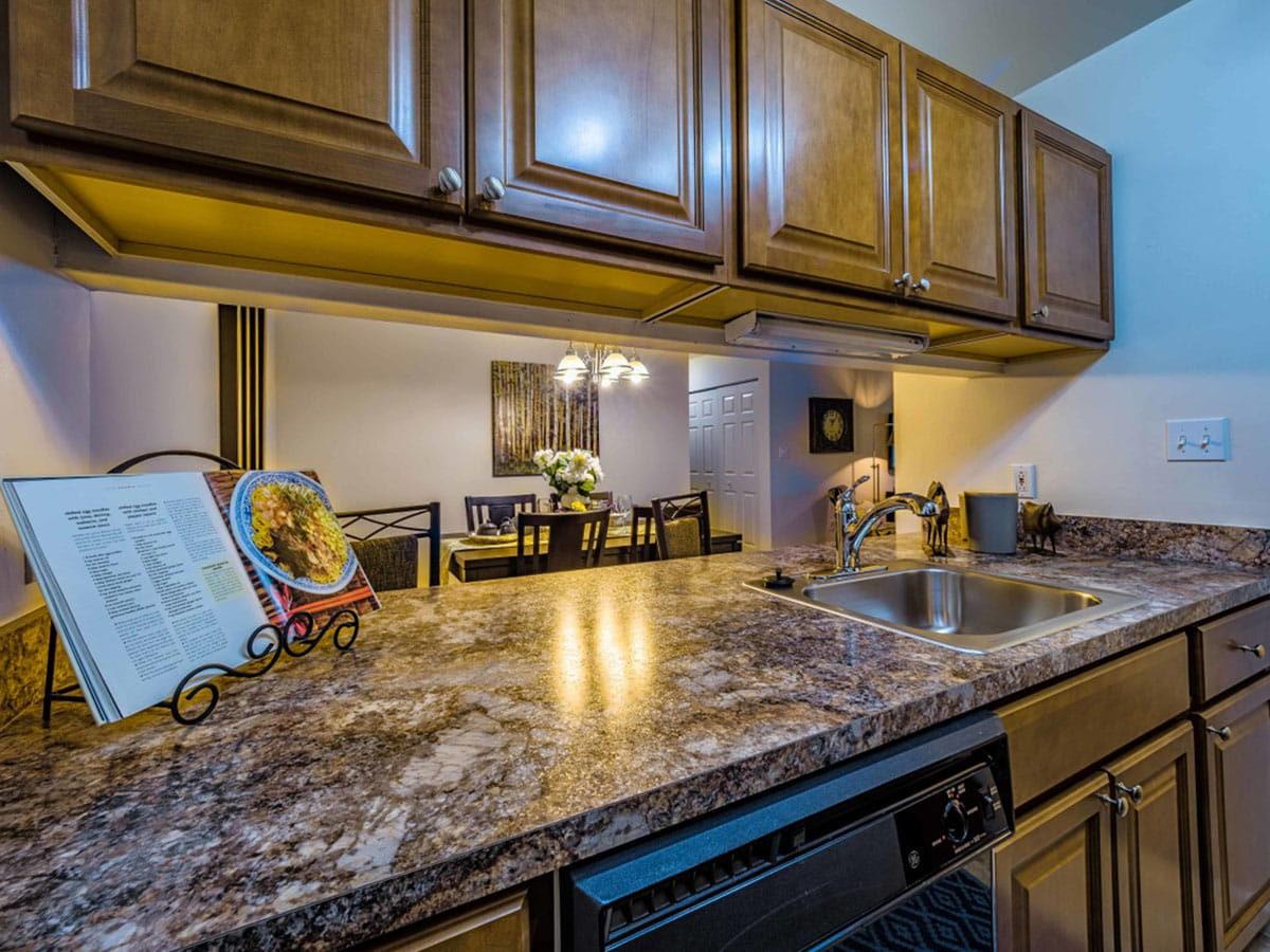 The Meadows apartment rental with wooden cabinetry and marble countertop in spacious kitchen in Lehigh Valley