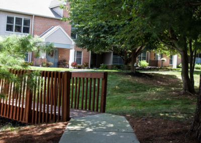 Exterior view of Lehigh Valley, PA apartment complex with mini bridge leading up to The Meadows leasing office